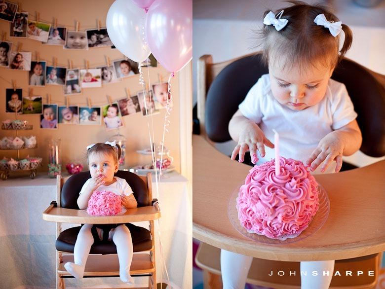 Little girl eating first bday cake